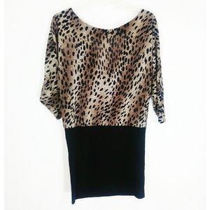 3/$20 Leopard print dress with black skirt size M